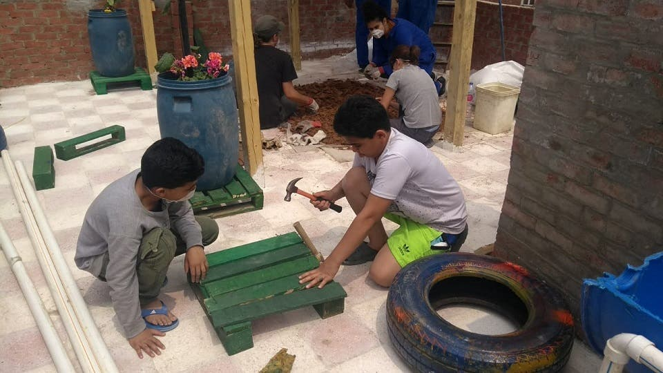 AUC Students Establish Sustainable Rooftop Community Garden in Informal Cairo Neighborhood