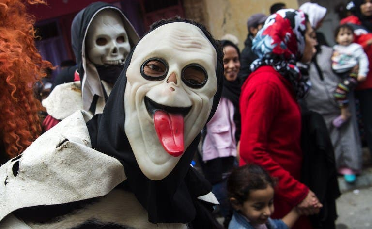Young Moroccans take part in the Boujloud festival, a popular celebration also known as the 'Moroccan Halloween' in the Sidi Moussa district of Sale near Rabat, on October 27, 2018.  FADEL SENNA / AFP