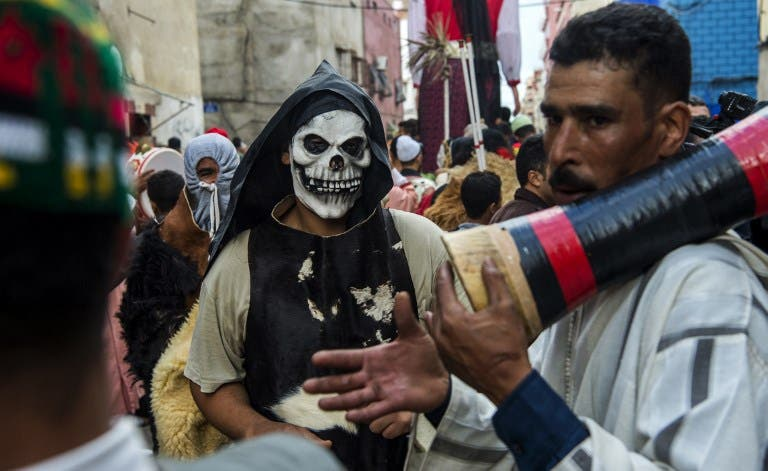 Young Moroccans take part in the Boujloud festival, a popular festival also known as the 'Moroccan Halloween' in the Sidi Moussa district of Sale near Rabat, on October 27, 2018.  FADEL SENNA / AFP