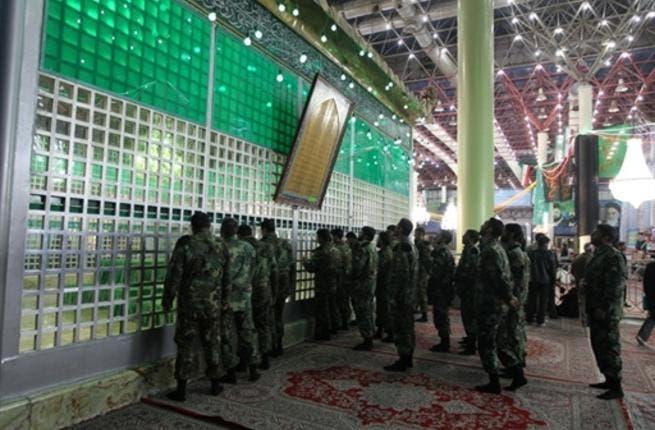 Iranian soldiers visit the shrine of Ayatollah Ruhollah Khomeini.