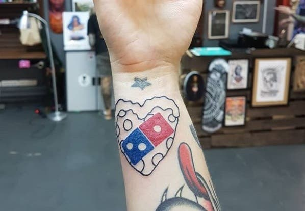 Many people gets a dominos tattoo if it meant I could get ONE free dominos pizza (Instagram)