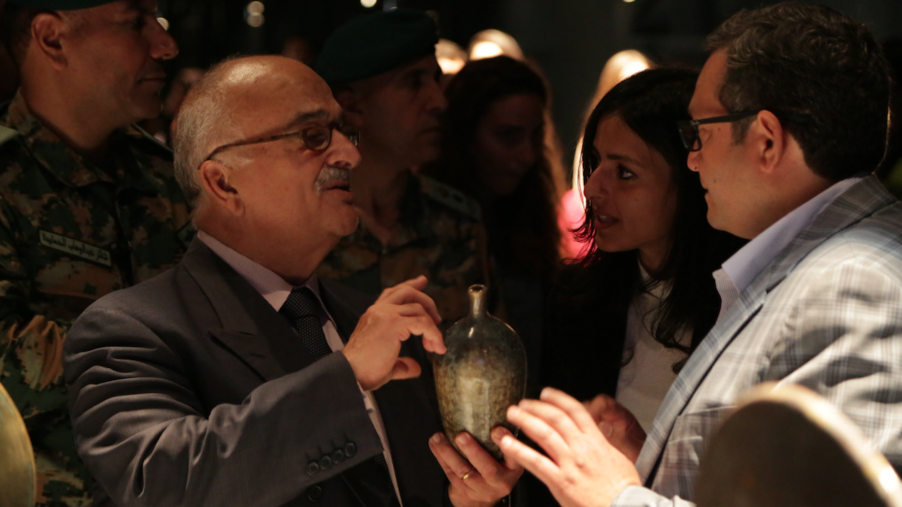HRH Prince Hasan, the brother of the late King Hussein bin Talal of Jordan, holds a crystal-ware vase created by Aymen Azzam. (Al Bawaba/Salim Essaid)