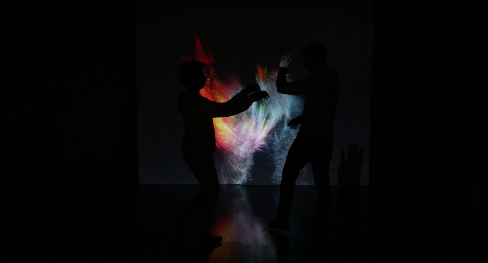 Two boys wave their arms to create spiritual-like expressions of their movement with light. An exploration project of the digital and physical by Jordanian multidisciplinary visual artist Andrei Snobar. (Al Bawaba/Salim Essaid)