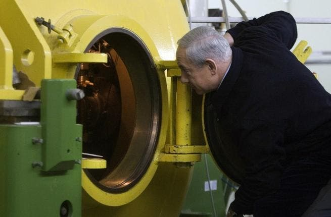 Israeli Prime Minister Binyamin Netanyahu visits the electronic accelerator lab in the Ariel University Center. (AFP Photo/ Dan Balilty)