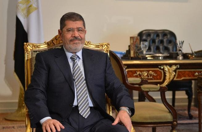 Egyptian president Mohamed Morsi poses prior to a meeting with Iranian Foreign Minister in Cairo. (AFP PHOTO / KHALED DESOUKI)