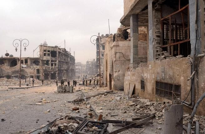 Syrian government troops take position in a heavily damaged area in the old city of Aleppo. (AFP PHOTO/STR)