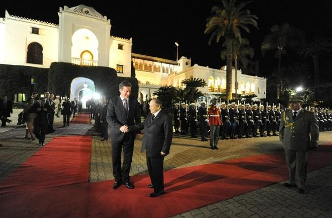 Algeria's President Abdelaziz Bouteflika (R) greets British Prime Minister David Cameron upon his arival at the People's Palace in the capital Algiers on Thursday. (AFP PHOTO/ FAROUK BATICHE)