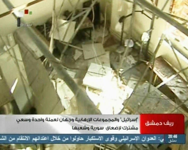 An image grab taken from the state-run Syrian TV , shows a room damaged after what Syria said was an Israeli air raid which targeted the Jamraya scientific research base on the outskirts of Damascus. (AFP PHOTO/SYRIAN TV)