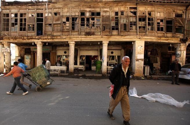 Iraqis walk in al-Rasheed street, the oldest street in the Iraqi capital Baghdad. (AFP PHOTO/PATRICK BAZ)