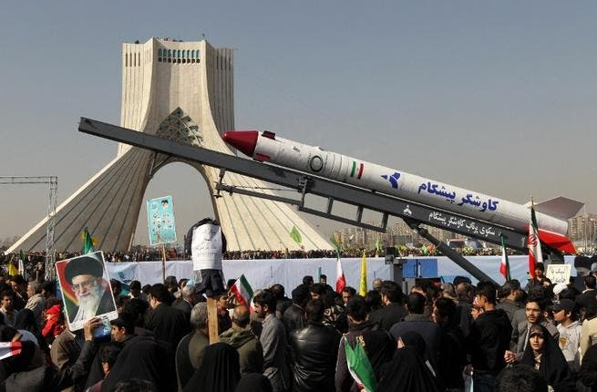 The capsule that was sent into space containing a live monkey in January is displayed during a rally in Tehran's Azadi Square (Freedom Square) to mark the 34th anniversary of the Islamic revolution. (AFP PHOTO / ATTA KENARE)
