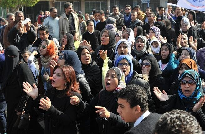 Egyptians rally on Sunday, closing down government offices and factories in the Suez Canal city of Port Said. (AFP PHOTO/STR)