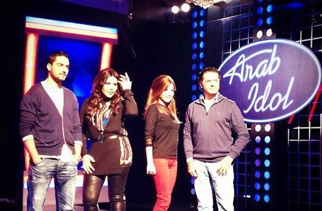 The Arab Idol judges get together.
