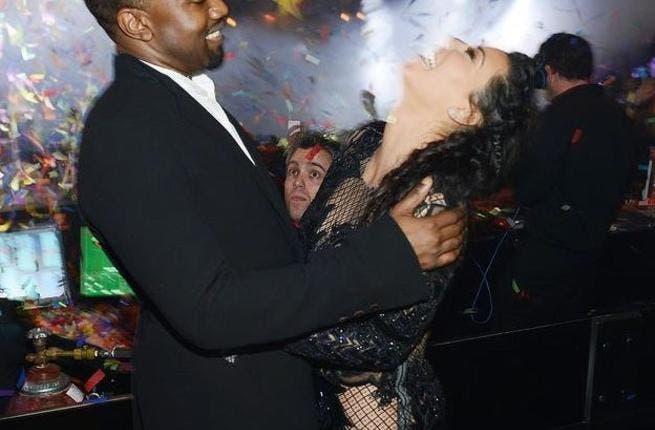 Kanye and Kim in a tender embrace.