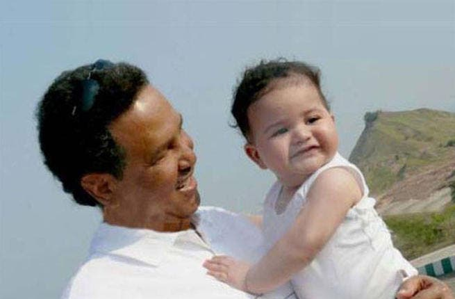 Proud Daddy Mohammed Abdo and his son Khaled (Image: Facebook)