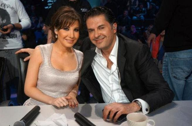 Nancy Ajram (L) and Ragheb Alama behind the scenes.