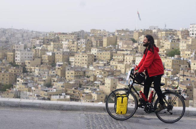 Don't get tyred! Somen Debnath at the Amman Citadel, Jordan. The round-the-world cyclist is undeterred by instability in Middle East
