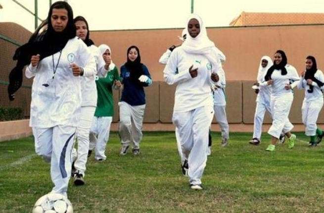 Girls in Saudi Arabia play football. Image via Al Arabiya
