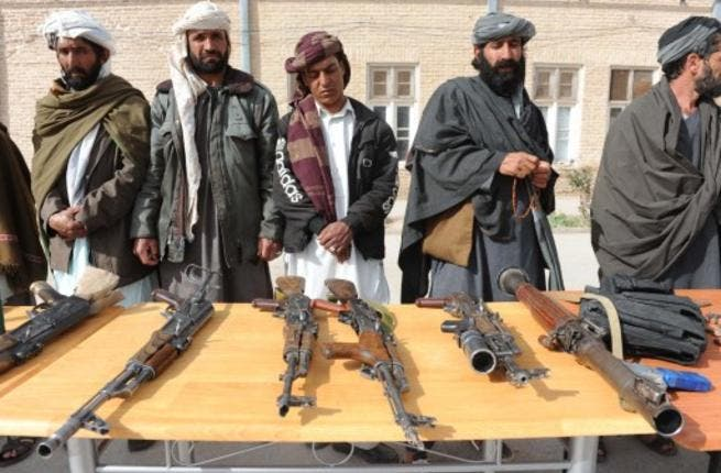 Former Taliban fighters hand over their weapons (File photo used for illustrative purposes)