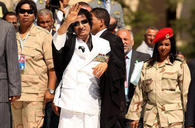 Gaddafi and his