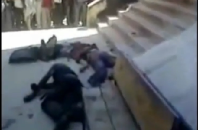 Bodies of the regime soldiers land on the floor