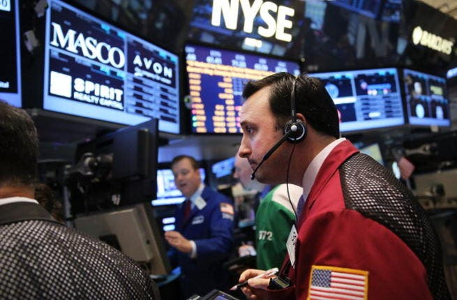 As investors wait for the Federal Reserve's policy-making committee to conclude its two-day meeting, the Dow Jones industrial average, S&P 500 and the Nasdaq all declined 0.4% in morning trading. (Photo by Spencer Platt/Getty Images)