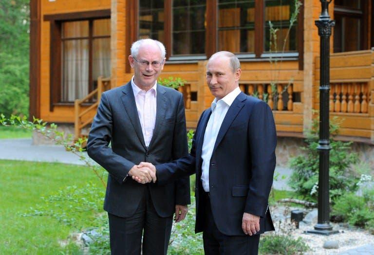 Russia's President Vladimir Putin shakes hands with EU President Herman Van Rompuy (Mikhail Klimentyev/ AFP)