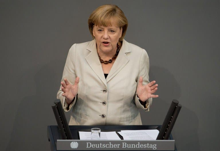 German Chancellor Angela Merkel makes a speech on the outcome of last week's G8 summit and the EU summit beginning in Brussels at the Bundestag (Johannes Eisele / AFP)