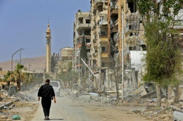 ابنية مدمرة في احد شوارع دوما في صورة التقطت خلال جولة نظمها الجيش السوري