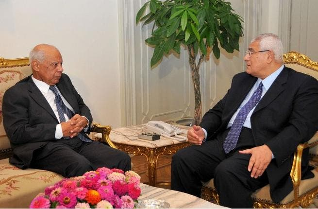 Egypt's interim president Adly Mansour (R) meeting with with new-appointed Prime Minister Hazem al-Beblawi, on July 9 (AFP/ Egyptian presidency)