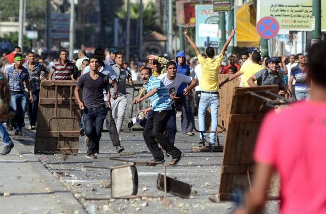 EGYPT, Alexandria : Supporters of the Muslim Brotherhood and Egypt's ousted president Mohamed Morsi clash with opponents to ousted president Morsi in the Mediterranean city of Alexandria on July 26, 2013. AFP PHOTO/STR