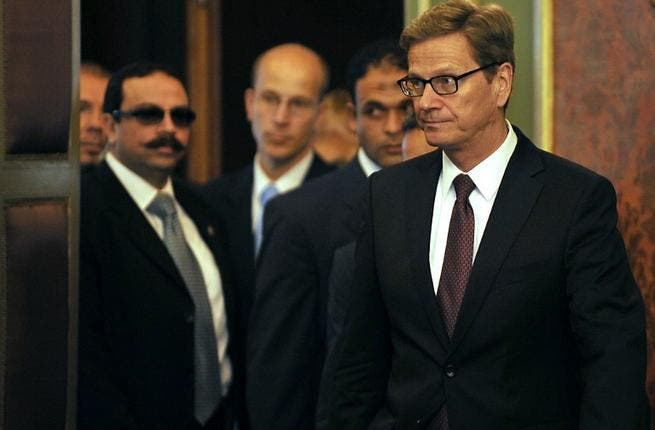 EGYPT, Cairo : German Foriegn Minister Guido Westerwelle (R) arrives with his Egyptian counterpart Nabil Fahmy (unseen) to give a joint press conference following their meeting in Cairo on August 1, 2013. AFP PHOTO/FAYEZ NURELDINE