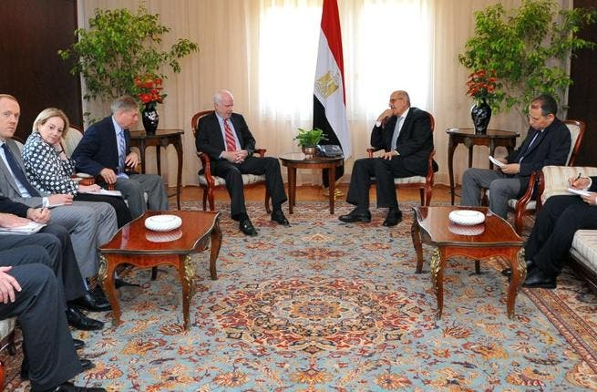 EGYPT, Cairo : A handout picture made available by the Egyptian presidency on August 6, 2013, shows Egypt's Vice President Mohamed ElBaradei holding talks with the US Senator John McCain on August 6, 2013 in Cairo.