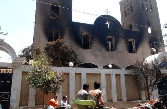 EGYPT, MINYA : A picture taken on August 14, 2013, shows the facade of the Prince Tadros Coptic church after being torched by unknown assailants in the central Egyptian city of Minya. AFP PHOTO/STR