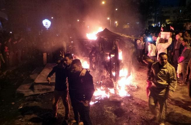 Angry Egyptians set fire to a microbus, said to be belong to a company owned by a businessman who supports the Muslim Brotherhood, after passengers allegedly held up four fingers, the symbol known as