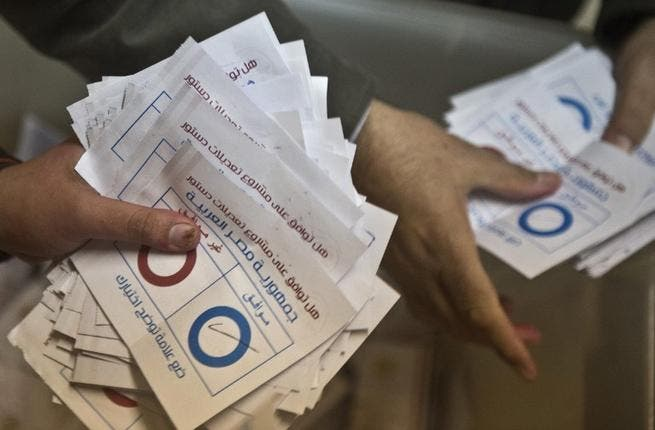 Polling station officials count ballots in the Egyptian capital Cairo on January 15, 2014. [AFP]