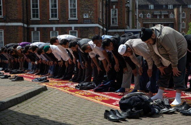 Muslims attend Friday prayers in the sunshine at the BBC Community Centre in the Spitalfields area, London, UK (Getty)