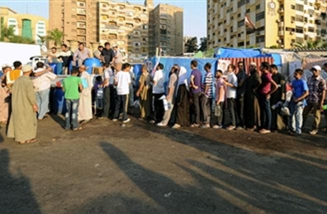 Egyptian supporters of Egypt's deposed president Mohamed Morsi queue to receive food just before breaking their fast during their ongoing sit-in protest outside Rabaa al-Adawiya mosque in Cairo on July 31, 2013.  (FAYEZ NURELDINE/AFP/Getty Images)