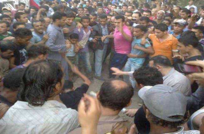 Angry Mob Beating A Shiite in Zawya Abu Muslam village (Source:Hazem Barakat)