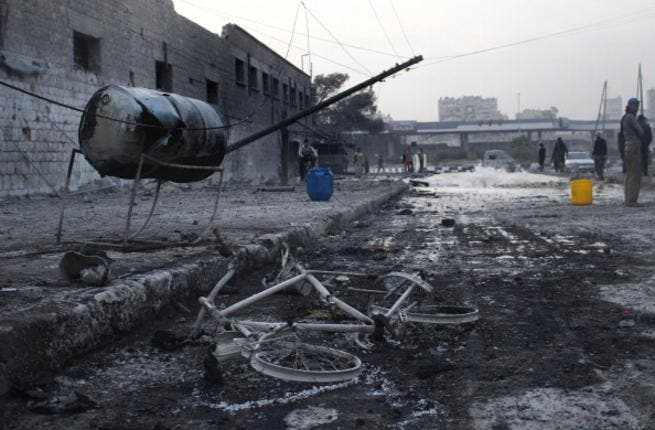 An air strike by pro-government forces on the Syrian city of Aleppo on November 28, 2013. [Mohammad Al-Khattib/AFP]