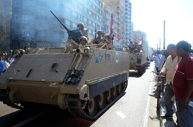 Egyptian security forces patrol after attacks. [AFP]