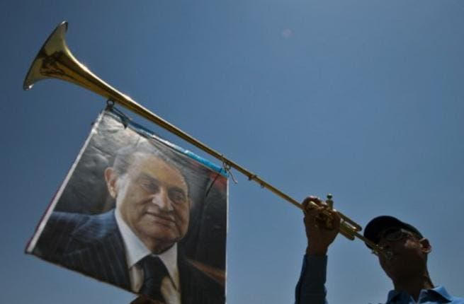 After one Mubarak fan hoisted his photo aloft a trumpet for May 11, the re-trial is once again postponed