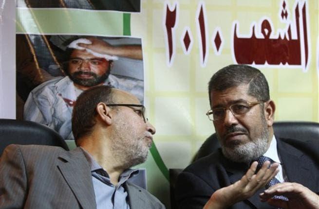 Muslim Brotherhood vice chairman Essam Elerian talks to Egypt President Mohamed Morsi