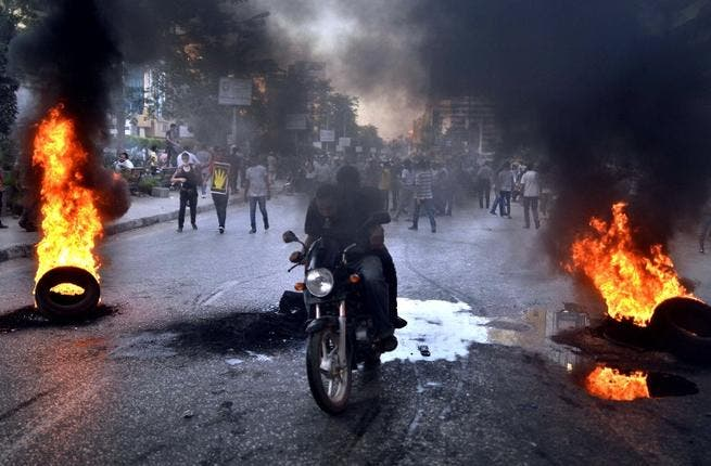EGYPT, Cairo : Supporters of the Muslim Brotherhood and Egypt's ousted president Mohamed Morsi clash with security forces, in Cairo, on August 30, 2013. TOPSHOTS/AFP PHOTO/MOHAMED EL-SHAHED