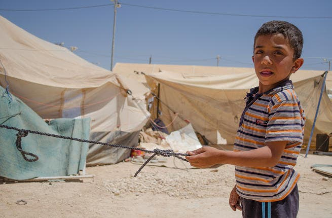Just over half the refugees in Zaatari are under the age of 18, and these youth are certainly thrown into the eye of the Syrian storm.  It's all hands on deck as children face the very adult realities of survival and setting up camp. (AlBawaba/J. Zach Hollo)