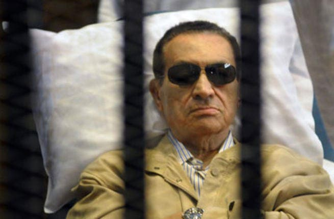 Egypt's former president inside a barred cage in the police academy courthouse in Cairo, Egypt. [alahram]