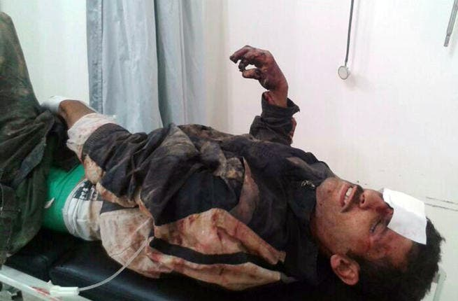 A wounded man is brought to a hospital in the eastern Lebanese city of Baalbek (AFP/STR)