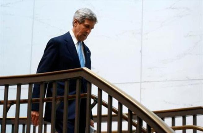 U.S. Secretary of State John Kerry arrives on Capitol Hill before he briefs members of the Senate Banking Committee behind closed doors about Iran and his recent negotiations in Europe, November 13, 2013. [REUTERS]