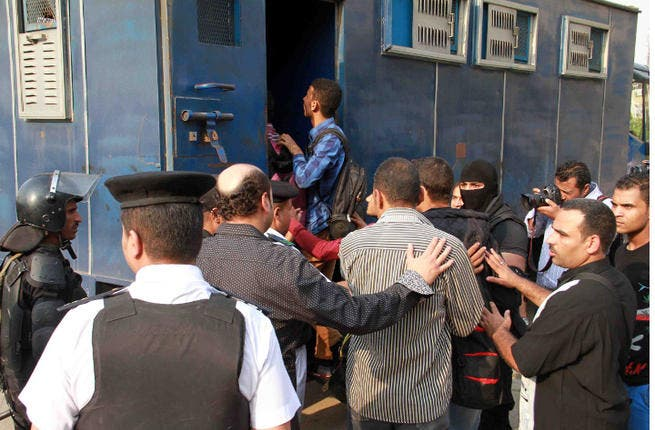 Egyptian policemen in plain clothes detain students of al-Azhar University in Cairo on October 30, 2013. (Image credit: AFP)
