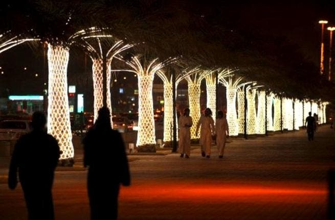 Saudi nights filled with lights: Saudis walk on King Abdullah Street decorated with lights ahead of celebrations for Eid al-Fitr. Lights mark the whole season of Ramadan and are aglow during Eid especially, sometimes complementing firework displays.