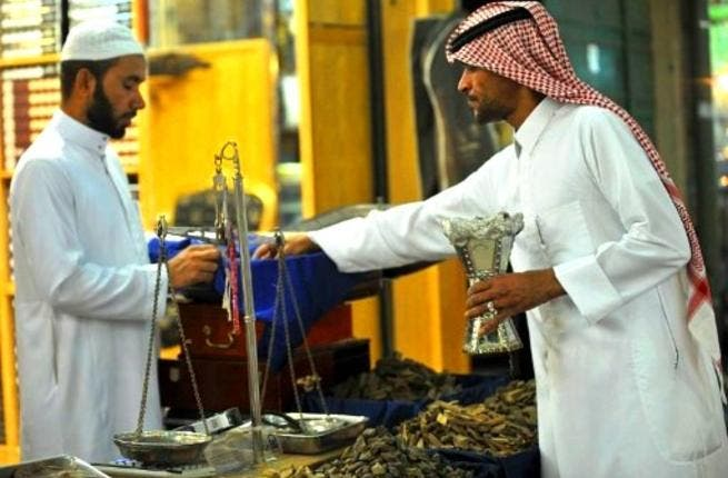 KSA: A Saudi man buys incense outside a shop at the Mecca market in central Riyadh in readiness for Eid, 